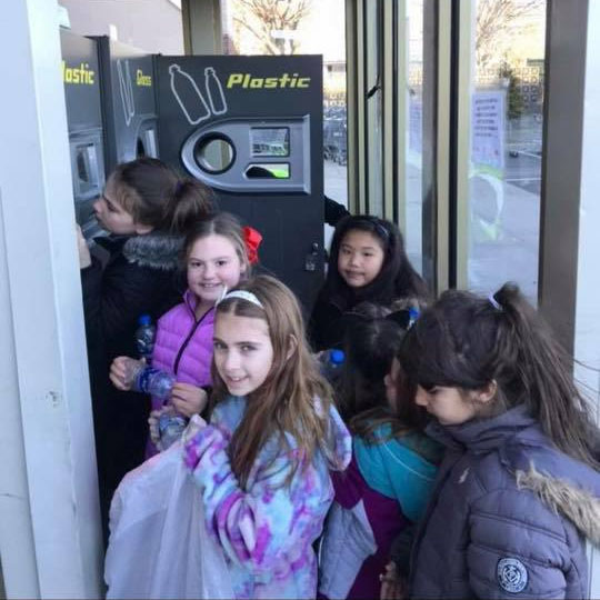 Girl Scouts Collecting Recycleables