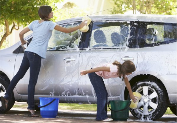 Youth Squad Volunteers Raise Funds with a Car Wash.
