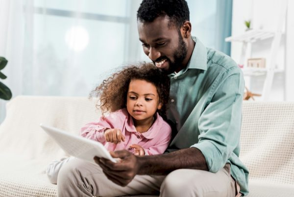 Dad and daughter learning together.