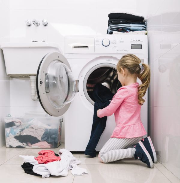 Teach kids responsibility by asking for help with laundry.