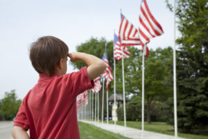 Boy Showing Respect for the Flag by Saluting on Memorial Day