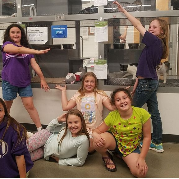 Girl Scouts volunteer with the ASACP